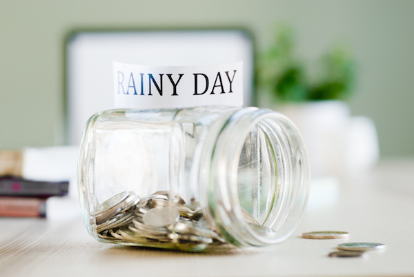 How to Save for a Rainy Day When You're in Debt